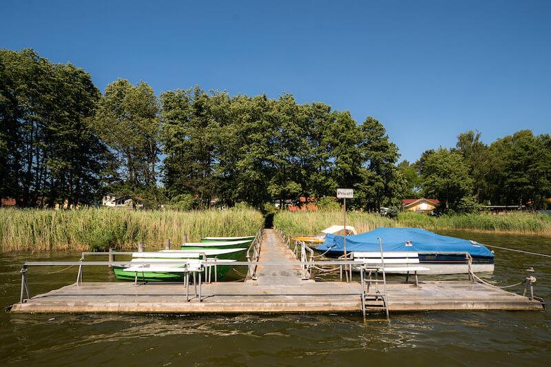 Steg Ruderboot schwimmen baden